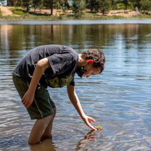 boy near pond copy
